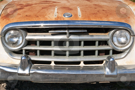 Rusty Old Car Grill stock photo, Close up of 1957 car's grill, sitting outside a Florida junk yard waiting for someone to buy, then restore it. by Steve Carroll