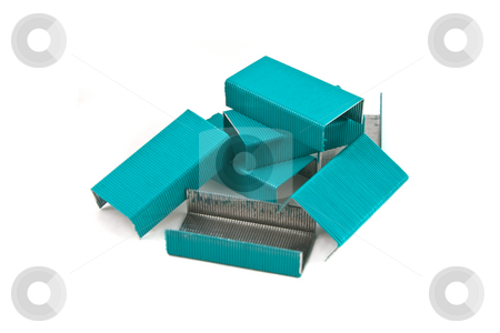 Pile of colored staples stock photo, Turquoise colored stapels isolated against a white background by Steve Carroll