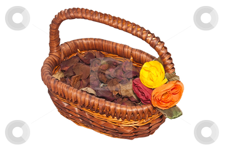 Basket of Potpourri stock photo, A wicker basket full of Potpourri, trimmed with three silk flowers. by Steve Carroll