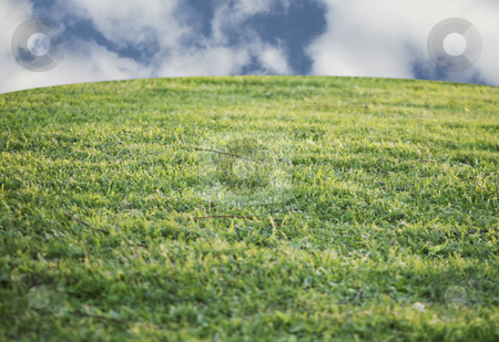 Beautiful sky with grassy hill stock photo, Grassy hill with beautiful sky by Stacy Barnett