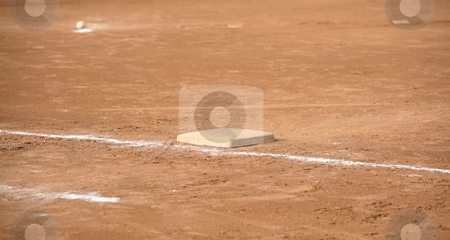 Base and ball stock photo, Ball near pitcher's mound and base by Stacy Barnett