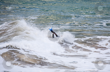 Face Plant stock photo, A young man on a Boogie Board getting a face plant from an unexpected wave by Mike Dawson