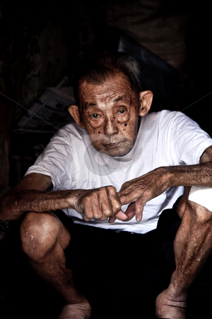 Old man waiting stock photo,  by Jimme Woudstra