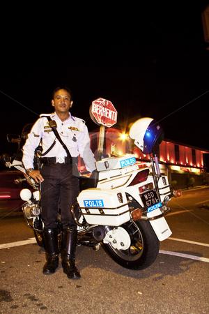 Police man in Malacca stock photo, Police man, policeman, bike, night, police, Malacca, Malaysia by Jimme Woudstra