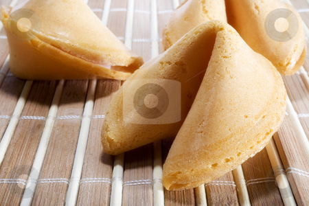 Fortune cookies  stock photo, Fortune cookies over Bamboo placemat by iodrakon