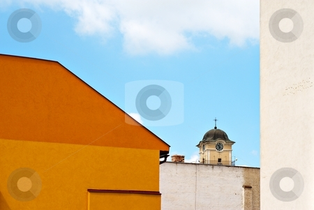 Orange facade and tower stock photo, Old city with a church tower by Juraj Kovacik
