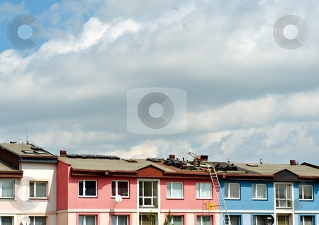 Roof reconstructon stock photo, Reconstruction of a roof in a sunny day with sky by Juraj Kovacik