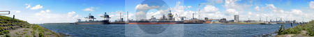Industrial Skyline stock photo, The industrial skyline of a huge steel plant, with two bulk carriers with coal and iron ore being unloaded by Corepics VOF