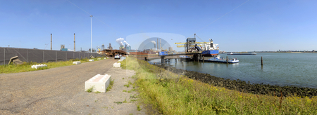 Industrial activity stock photo, Industrial activity, with the loading and unloading of ships at a huge, integrated, steel plant on a bright summer day by Corepics VOF