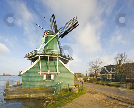 Old Dutch Windmill stock photo, An old Dutch windmill, used to grind mustard seeds at the tourist attraction
