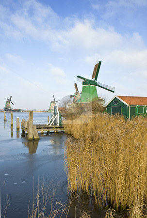 Four windmills in the Zaanse Schans stock photo, Four old, typically Dutch windmills at the tourist attraction