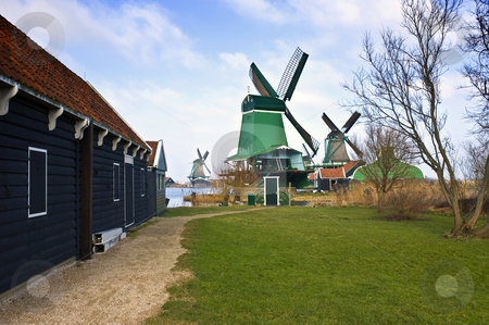 Zaanse Schans Windmills stock photo, The old, typically Dutch windmills and barn at the tourist attraction