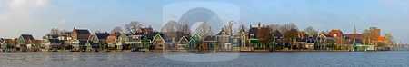 Zaanse Schans stock photo, The old, picturesque houses of Zaanse Schans along the river side of the Zaan on a cold winter morning by Corepics VOF