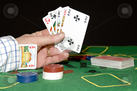 Cheating stock photo, Having a card up your sleeve: Cheating at poker, or committing adultery; taking chances, risking everything by Corepics VOF