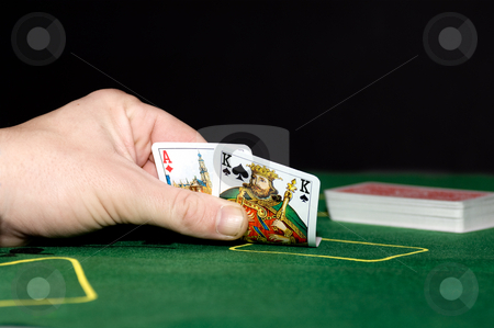 Black Jack stock photo, A black jack player holding an ace and a king - full black jack by Corepics VOF