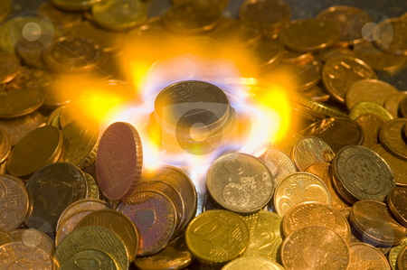 Money to Burn stock photo, A glowing red hot coin in front of the blue flames of burning natural gas, a metaphor of wasting energy, not only bad for the environment, but also a waste of money by Corepics VOF