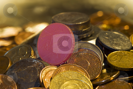 Glowing coin stock photo, Theme: Money to burn. A stack of well used coins, with a glowing hot coin in the center. by Corepics VOF