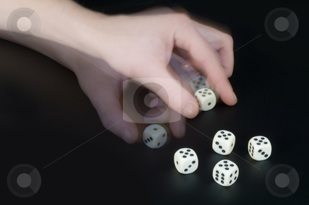 Cheating stock photo, A man cheating whilst playing dice, turning a dice to his advantage by Corepics VOF