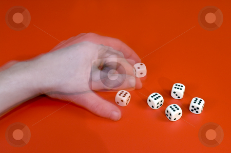 Cheating with dice stock photo, A man's left arm changing a dice, cheating at a game by Corepics VOF