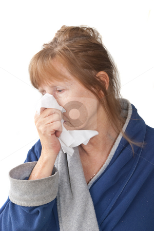 Mature Woman with Cold stock photo, Mature woman with cold wearing housecoat and blowing nose, isolated on white background by Steve Carroll