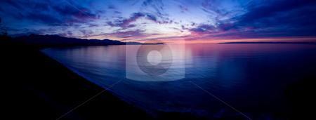 Strait of Juan de Fuca Sunset stock photo, A beautiful sunset over the Strait of Juan de Fuca in Sequim. Panoramic photo. by Travis Manley