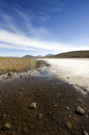 Islandic landscape stock photo, The barren, desolate Icelandic landscape with eternal snow and a rocky tundra desert near the Langjokull glacier by Corepics VOF