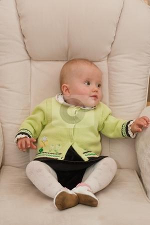 Little baby girl stock photo, Cute caucasian little baby girl sitting o a chair. by Mariusz Jurgielewicz