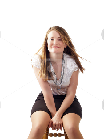 Young woman in black skirt sitting on stool stock photo, Young woman in white blouse and black skirt sitting by Jeff Cleveland