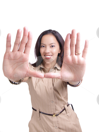 Young hispanic woman framing face with hands stock photo, Smiling latina woman with hands framing face by Jeff Cleveland