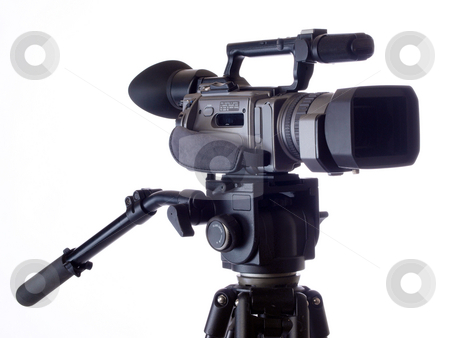 Black Video camera mounted on tripod against white stock photo, Mid-price video cameral on tripod against white background by Jeff Cleveland