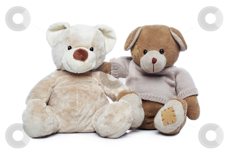 Two Teddy bears hugging each other over white background stock photo, Two Teddy bears hugging each other over white background by Ivelin Radkov