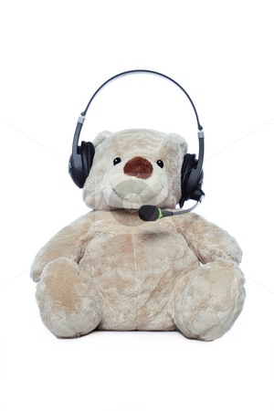 Teddy bear with headset stock photo, Teddy bear with headset isolated over white by Ivelin Radkov
