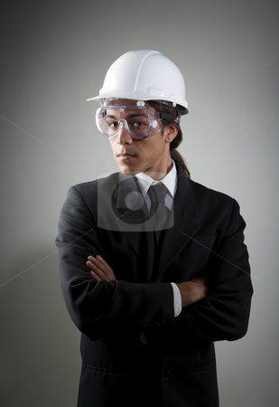 Young mixed race man in hard hat and safety goggles stock photo, Handsome young mixed race man in hard hat and safety goggles by Scott Griessel