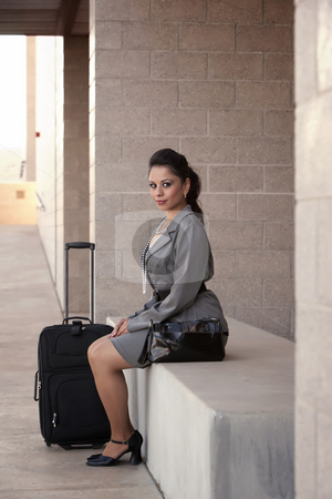 Hispanic Woman Traveler stock photo, Pretty young Hispanic woman with roller suitcase by Scott Griessel
