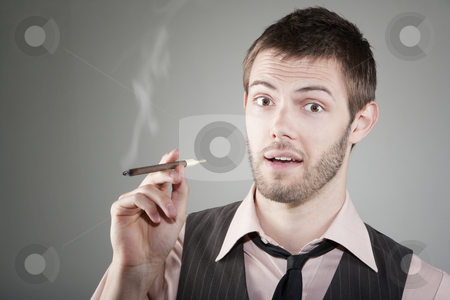 Happy young man with small cigar stock photo, Portrait of happy young Caucasian man with small cigar by Scott Griessel