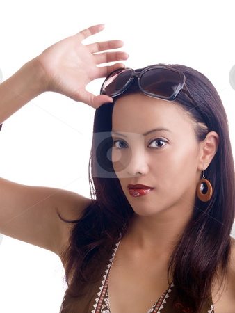 Young hispanic woman with sunglasses on top of head stock photo, Young latina woman holding sunglasses up above forehead by Jeff Cleveland