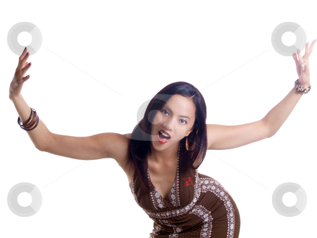 Young hispanic woman with exagerated gestures brown dress  stock photo, Young latina woman with arms and mouth wide open by Jeff Cleveland