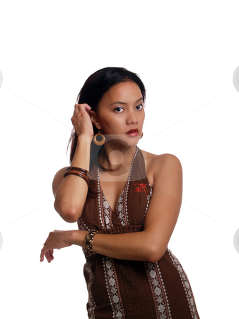 Young latina woman in brown dress half-length stock photo, Young hispanic woman in brown dress guarded look by Jeff Cleveland