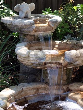 Three levels of cascading pond waterfall in garden stock photo, Tight shot of garden waterfall pond with 3 levels by Jeff Cleveland