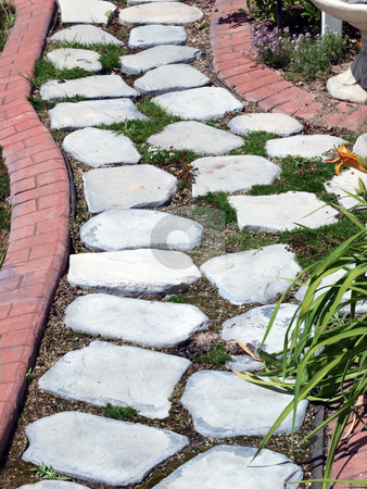 Garden path of stepping stones with brick pattern boarder stock photo, Garden path with fake brick cement boarder by Jeff Cleveland