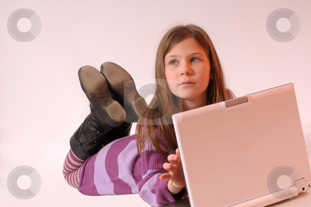 Girl working stock photo, Girl working on white laptop by Dragos Iliescu
