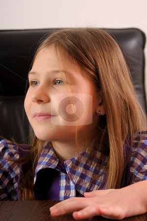 Girl in office stock photo, Little girl sitting in a black chair by Dragos Iliescu
