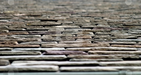 Roof Top stock photo, Abstract close up of stone roof tiles. by Henrik Lehnerer