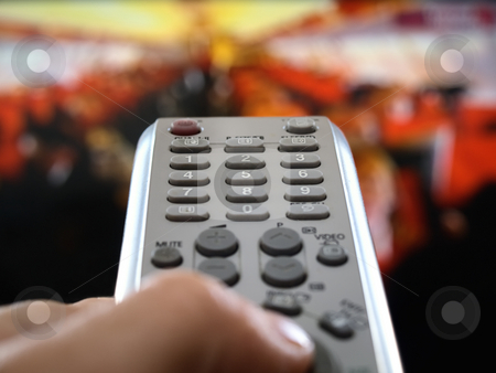 The world under control stock photo, Closeup of a hand  holding the remote control in front of the television, shallow DOF, conceptual image of the world under control by Vladimir Koletic