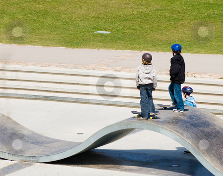 Skateboard Park stock photo, A couple of children playing outside at the local skateboard park by Richard Nelson