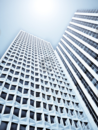 Skyscrapers stock photo, Two skyscrapers under the sun by Laurent Dambies