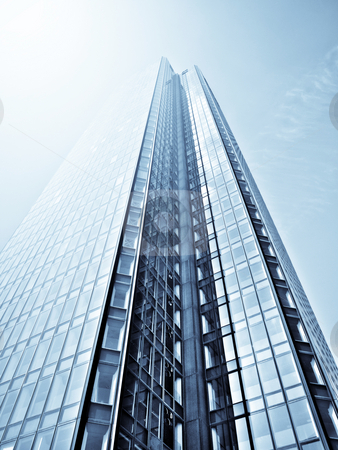 Skyscaper and sunlight stock photo, Modern glass skycraper with sunlight by Laurent Dambies