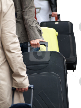 Travellers at the airport stock photo, Travellers with suitcases isolated on white by Laurent Dambies