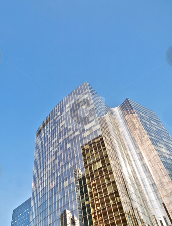 Skyscrapers stock photo, Skyscrapers under blue sky with reflection on glass by Laurent Dambies