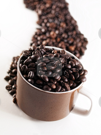 Spilled coffee beans stock photo, Mug filled with coffee beans and spilled beans by Laurent Dambies